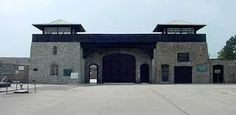 Photograph of prisoners' gate at Mauthausen concentration camp Exterior Doors, Interior And Exterior, Privacy Fences, Fencing, Getting Rid Of Clutter, Getting Bored, Double Doors, Light Shades, Merida