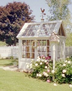 garden shed made from old windows. White on white home decor and interior design inspiration - antique furniture, vintage lamps and retro home accessories from Ruby Lane www.rubylane.com @rubylanecom #VintageLamp