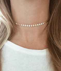 This has by far become my favorite go to choker. It features gold disks all the way around the necklace from end to end and is all made out of 14/20 gold-fill. You get to customize the length of your choker to ensure it lays where you want it to on your neck. Pictured is 13.5. If you need a different length, please write me a note at checkout requesting what length you need. This necklace can be worn alone, or is perfect for laying, as it is shown here with our...  Triple Cross Necklace…