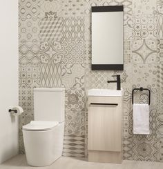 Large rectangular tiles can help a small room feel larger. The way you lay them will have an effect too....vertical tiles make a room feel taller, where a brickwork pattern elongates a room.