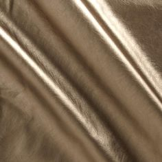 Patina Faux Leather Knit Gold from @fabricdotcom  This medium weight faux leather knit is perfect for creating leather-look leggings, heavier tops, and apparel accents such as pockets, patches, collars or cuffs. This fabric is comprised of a poly single knit backing with a metallic polyurethane laminated face. It is soft and pliable with with 25% stretch across the grain.