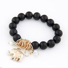 Black bracelet with the little golden elephant - it brings luck!