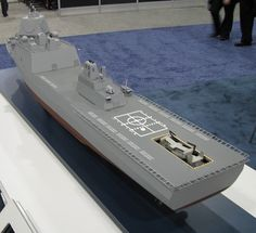 An interesting ship model was unveiled April 8 by Huntington Ingalls Industries at the Navy League's Sea-Air-Space gathering outside Washington: a ship intended primarily for the ballistic mi… Model Warships, Scale Model Ships, Ballistic Missile, Air Space, Concept Ships, Armada, Navy Ships, Aircraft Carrier, Royal Navy