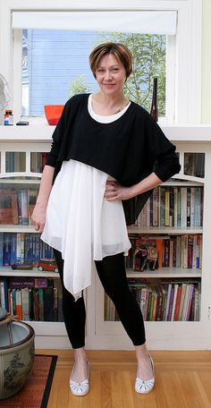 I love this look! Cropped black top + white dress (long filmy top over short opaque lining) + black leggings.