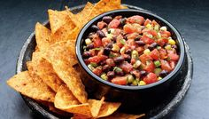 Black Bean and Corn Salsa: Fresh summer flavors any time of the year! Our tomatoes combined with corn and black beans, green onions and cilantro make the best dip. All you need is a sturdy chip!