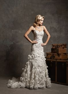 Justin Alexander jar style 8642 Spaghetti straps in regal satin with beaded sweetheart over metallic lace, regal satin pleated cummerbund, metallic lace mermaid with crinkle organza bows and lace spiral ruffles buttons over back zipper and chapel length train.
