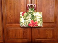 Back to the 1940s with this Hawaiian style vacation purse. Tutorial from sew4home.com and fabric from fabric.com. The black cherry handles are discontinued but I was able to find two pair on etsy.