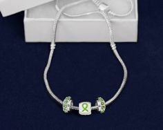 Chunky Lime Green Ribbon Necklaces.  The necklace has 3 charms, two having lime green crystals and the third having lime green ribbons all the way around. This lime green ribbon necklace is approximately 17 inches long. Each necklace comes in a gift box with cotton insert. This is a wholesale pack that contains 12 necklaces. (N-04-9)