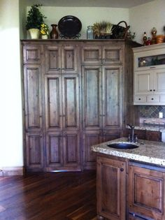 Awesome hidden pantry behind cabinet!