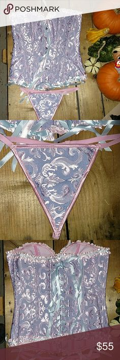 NIB LACE UP CORSET AND THONG SET This is such an adorable corset set! The colors truly make me think of cotton candy! Light blue and pink jacquard fabric with flexible steel boning, it provides excellent support! Super cute ribbon details and lace up back. Front has a hook and eye closure. There is only one row of clasps on the front, but the corset can be tightened or loosened on the back. Really cute under blazers, but is more suited for the bedroom, if you catch my drift! Brand new! Comes…