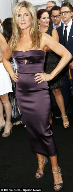 Jennifer Aniston in a satin strapless Burberry dress in a deep plum hue