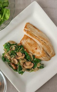 This Tilapia with Lemony Spinach and Mushrooms freezer recipe is light, lively and great for a relaxed family dinner or meal planning for the Lenten season. via @onceamonthmeals