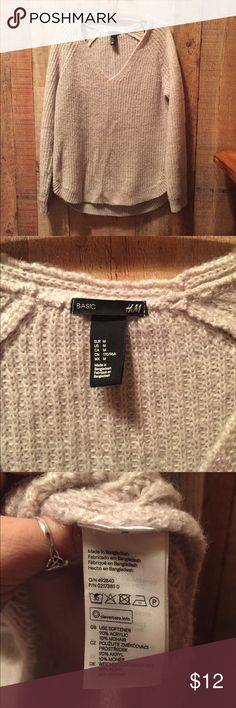 """H&M Tunic Sweater Tan sweater, Basic H&M. V-Neck with rounded hem, tunic style.  Back measures approx 28"""" long, front falls 2"""" shorter.  21"""" across.  This is one of those comfy warm sweaters to wear over a Cami and leggings.  90% acrylic 10% mohair.  There is minimal piling and I found a small pull on the arm (see pic).  Overall very good condition. H&M Sweaters V-Necks"""
