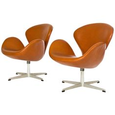 The Exchane Int Pair of Arne Jacobsen Swan Chairs | From a unique collection of antique and modern lounge chairs at https://www.1stdibs.com/furniture/seating/lounge-chairs/