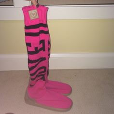 """Boots Victoria Secret ugg like boots. They are pink and black. Sweater knit. And they say """"love pink"""" Victoria's Secret Shoes Winter & Rain Boots"""