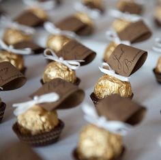 Ferrero Rocher chocolates were used to hold the escort cards. These edible treats were decorated with an ivory ribbon tie and topped with a . Wedding Favors And Gifts, Chocolate Wedding Favors, Edible Wedding Favors, Bridal Shower Favors, Diy Wedding Decorations, Edible Favors, Ferrero Rocher, Name Cards, Wedding Website