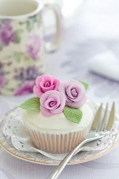 Pretty pastel rose adorned cupcakes