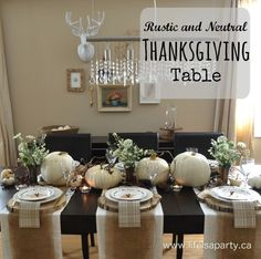 Rustic and Neutral Thanksgiving Table: Beautiful and inexpensive table decorated with wildflowers, little mini animals, tree stumps and white pumpkins. Perfect for a fall dinner, or Thanksgiving.