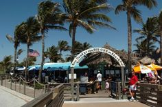 Sharky's is voted 2013 Best Florida Beach Bar (Photo: Sharkys on the Pier in Venice, from Sarasota Herald Tribune)