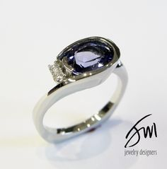 Perfect design to showcase this sparkling sapphire!   http://www.jackmillerjewelrydesigners.com/