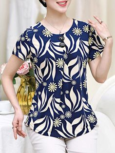 Best 12 Specifications Product Name: Round Neck Decorative Button Printed Short Sleeve T-Shirt Weight: Material: Polyester Occasion: Casual More Details: Decorative Button Season: Summer Sleeve: Short Sleeve Pattern Type: Printed Package Included: T Blouse Styles, Blouse Designs, Kurta Designs, Cotton Blouses, Shirt Blouses, T Shirt, Casual Tops, Casual Shirts, Blouse Vintage