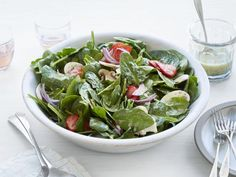 Katie Lee's pickled strawberries are easy to make and taste awesome in salads. Try them in her spinach salad with poppy seed dressing.