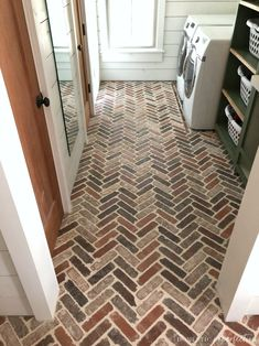 Thinking about putting a brick floor in your home? Read this post for information about where to buy brick tiles, cost, sealer, and more! #brick #brickfloor #bricktile #herringbone #floor #flooring