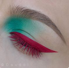 Teal eyeshadow and pink eyeliner