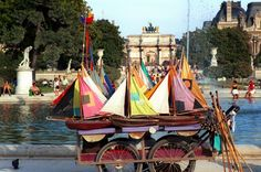Rent toy boats to sail in the pond at the Jardin des Tuileries, Paris France