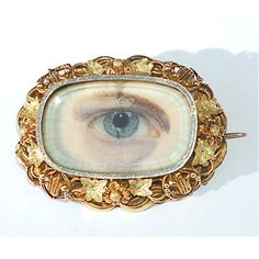 gold brooch with lover's eye painted on ivorine  date late 19th century
