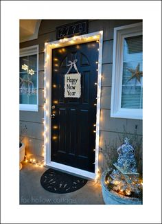 Beautiful & Easy DIY New Years Front Door. A wooden block/paint,glue gun,tinsel {burlap?},ribbon to hang the 'welcome', lights around front door, christmas half off goodies for the front door. All hung with Command strips!