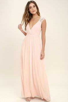 You can feel the magic in the air the moment you slip on the Whimsical Wonder Blush Pink Lace Maxi Dress! Lightweight chiffon shapes a pleated surplice bodice with lace straps. Fitted waist leads into a cascading maxi skirt. Hidden back zipper.