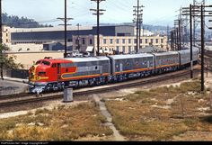 RailPictures.Net Photo: ATSF 23 Atchison, Topeka & Santa Fe (ATSF) EMD F7(A) at Los Angeles, California by cz17. From Mission Tower ,1970.  A San Diegan is seen backing out of the Union Passenger Station and is traveling around the north leg of the wye onto the ATSF main. Shot was taken from inside Mission Tower.