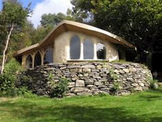 I like CH's almost free cabins :)  Add naturalized soil sloping upward to the stones for Insulation and Aesthetic values?
