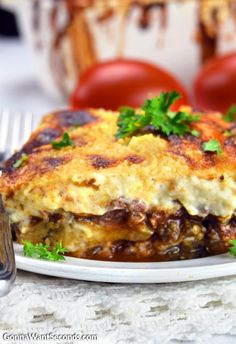 This Greek Moussaka Recipe Is comfort food at its finest. Ahearty, ooeygooey casserole made with delicious layers of a rich Tomato Meat Sauce and a luscious,creamy Cheese Sauce layered with Eggplant. Greek food might not come instantly to mind when you think of comfort food—but boy, after you try this delicious Greek moussaka recipe, it …