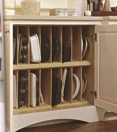 10 Ways to Organize Baking Pans - I can use thin MDF to create these slots in my kitchen cabinet.  It will be easy to find things as well as store baking things.