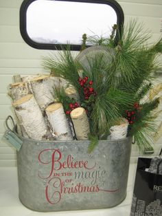 Gorgeous idea for #Christmas. The #vinyl #uppercaseliving expression looks great on a #galvanized bucket. #hostessgift #holidaygift #Christmasmagic #firewood #cozy #ultorre