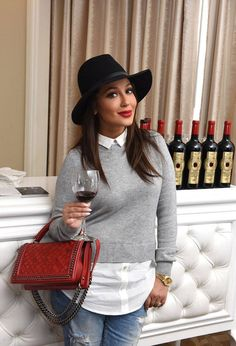 Adrienne Bailon from Oscars 2017: Party Pics  The Real co-host toasts awards season with a glass of Un Joyau Majestueux Ruby Cabernet Sauvignon while getting pampered at Debbie Durkin's EcoLuxe Lounge in L.A.