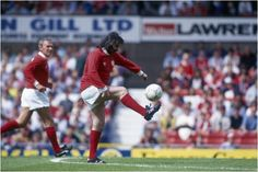 Manchester - 1991: George Best controls the ball during an Exhibition match held in 1991 at Old Trafford, Manchester, England.