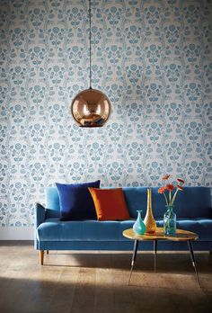 Tom Dixon copper shade and a blue velvet sofa.