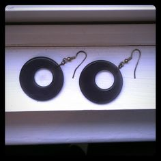 Mod Earrings These dangle earrings have a dangling mod grey circle. Maybe worn once or twice but not any visible wear. Jewelry Earrings