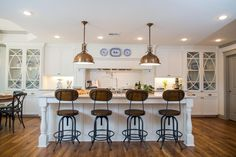 fixer upper open kitchen design with barstools