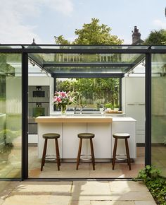 bulthaup by Kitchen Architecture 'Glass box extension on thatched cottage' case…