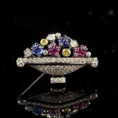 ART DECO TUTTI-FRUTTI BROOCH PAUL EMIL BRANDT France A beautiful Art Deco Tutti-Frutti jardiniere brooch, set with brilliant cut diamonds, two fancy yellow diamonds, two cut sapphires and two cut rubies.