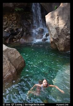 Picture/photo (Bathing and Swimming): Girl swims in cool pool at the base of Wapama falls. Yosemite National Park, California, USA.