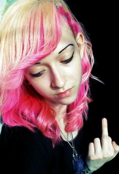 Love the blonde on pink with the classy curls. Middle finger, not so classy.