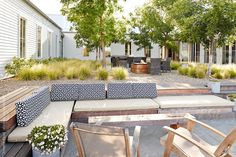 Outdoor courtyard patio at modern design farmhouse by trinettereed | Stocksy United