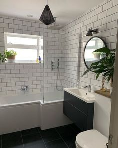 This fab industrial style cage pendant light looks so stylish in this chic monochrome bathroom. Downstairs Bathroom, Bathroom Inspo, Bathroom Inspiration, Small Bathroom, Bunnings Bathroom, Bathroom Ideas, Plafond Rose, Bathroom Pendant Lighting, Industrial Bathroom