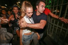 SOS! Cara had bodyguards on hand to help navigate her through the busy crowds