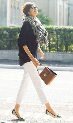 white pants, big scarf.